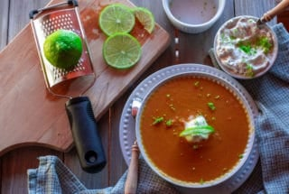 bowl of sweet potato soup with dollop of whipped cream