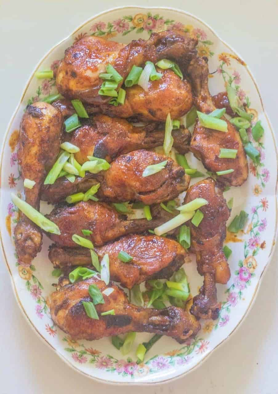 Sweet and Spicy Chili Chicken Legs (drumsticks).Sweet from apricot preserves and heat from hot sauce makes these legs a great appetizer or main course.#chicken #apricot #syrupandbiscuits