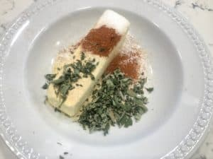 Butter with herbs and spices in a bowl.