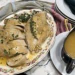Turkey breast with gravy on a platter