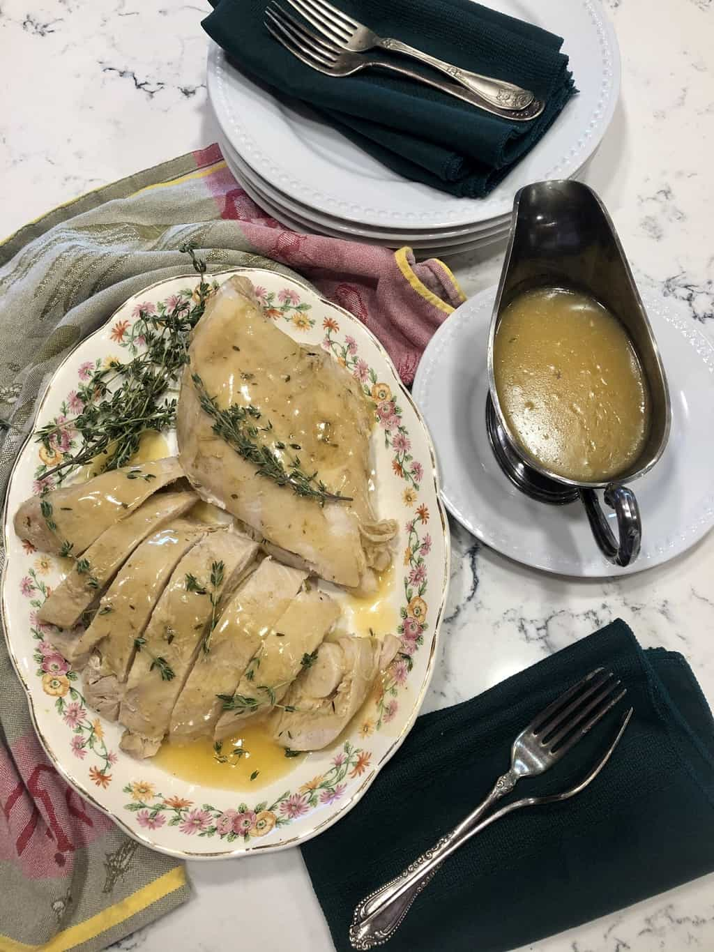 Slow-Cooker Turkey Breast with Gravy. Bone-in, skin-on turkey breast seasoned with flavored butter, cooked in a slow-cooker on a bed of fresh fruit, vegetables, herbs, and white wine. The flavorful cooking stock is thickened for gravy.