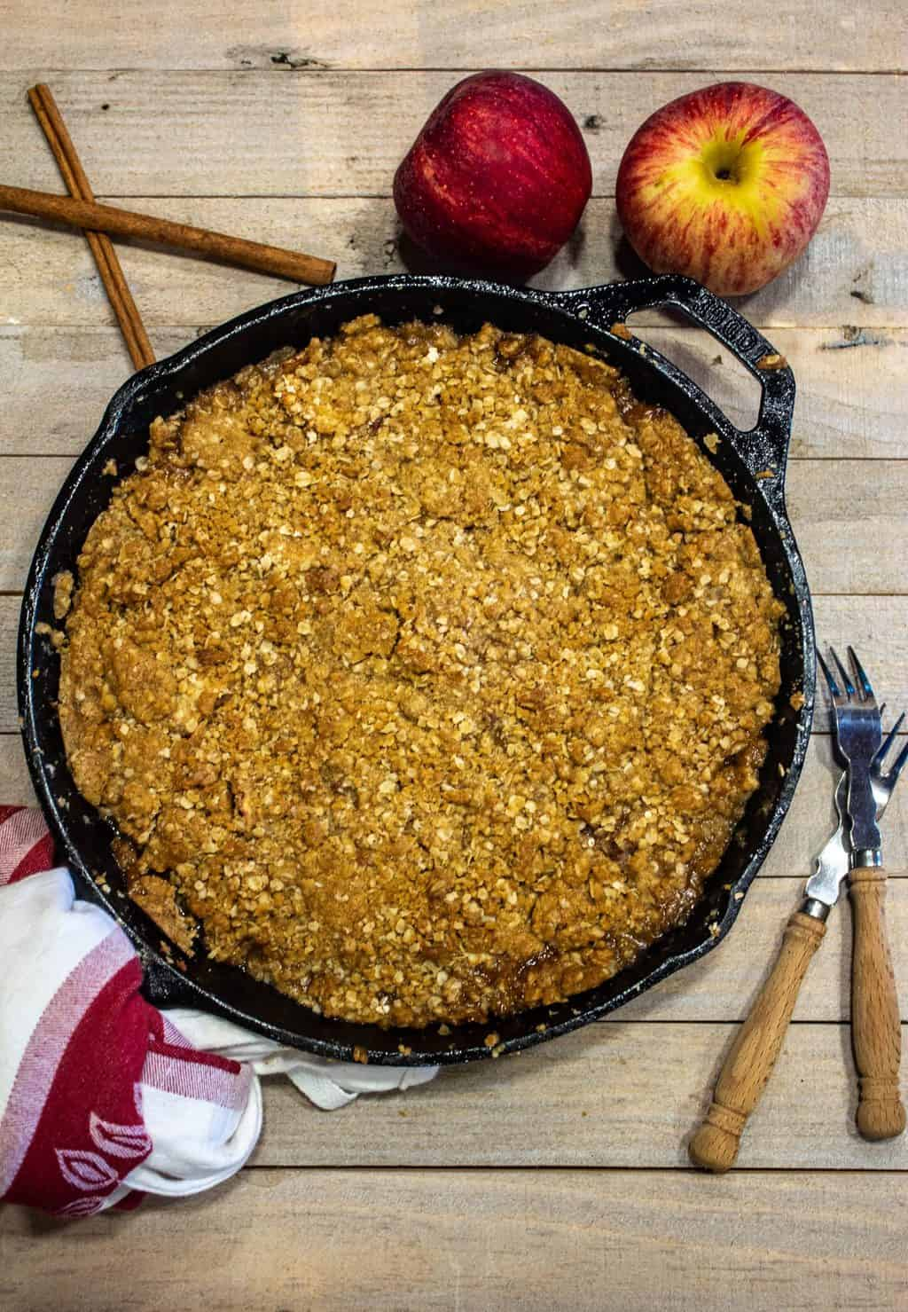 Skillet Apple Crisp is an old fashioned apple dessert made with orchard fresh apples and topped with an oatmeal and brown sugar crumble.